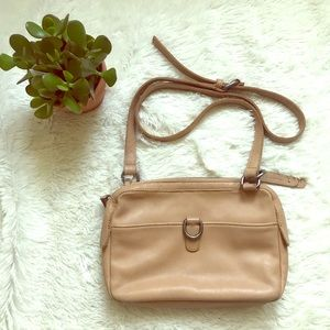 Lucky brand crossbody purse light tan in color